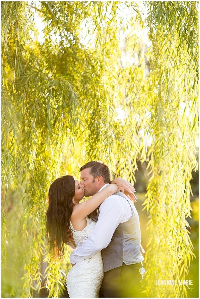 bride, groom, kiss, willow trees, sunset, Rolling Ridge Event Center, St. Cloud Floral, Custom Catering by Short Stop, Cold Spring Bakery, Geyer Wedding and Events, DJ Koeltrain, SM Hair and Makeup, The Wedding Shoppe, David's Bridal, Men's Wearhouse, barn wedding, rustic wedding, outdoor wedding, summer wedding, kid-friendly wedding
