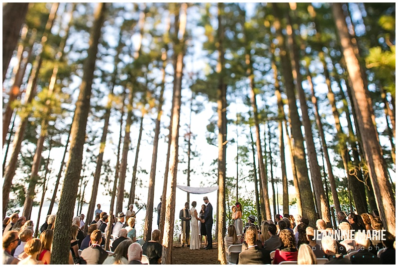 trees, wedding ceremony, guests, wide shot, bride, groom, chuppah, Camp Thunderbird, Lumberjack wedding, camping wedding, woodsy wedding, wedding in the woods, Bemidji wedding, Bemidji wedding photographer, Minnesota wedding photographer, Jeannine Marie Photography, summer wedding, plaid wedding, outdoor wedding, Up North wedding, Northern Minnesota wedding, Jewish Wedding, KD Floral, Fozzies BBQ, The Lost Walleye Orchestra, The Party Store, Crystal Greene, Anthropologie, Minnesota wedding