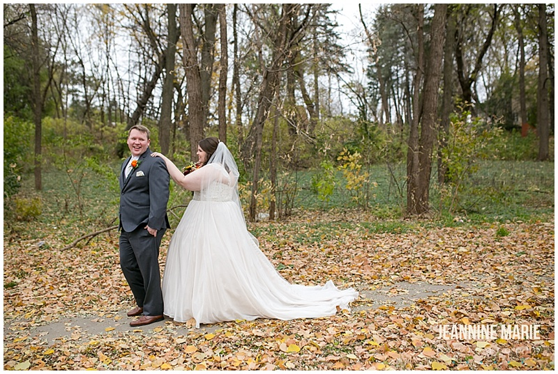 leaves, first look, bridal bouquet, fall flowers, wedding gown, wedding dress, gray suit, fall wedding, navy wedding, church wedding, Grace Lutheran Church, The Pavilion at Lake Elmo, Lakeside Floral, Lunds & Byerlys, Bellagala, Salon Ultimo, Luxe Bridal, Azazie, The Foursome, November wedding, Jeannine Marie Photography, Minnesota wedding photographer, Saint Paul wedding photographer