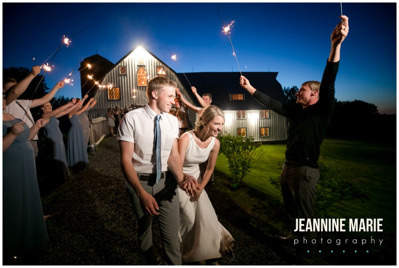 bride, groom, sparklers, Bloom Lake Barn, summer wedding, barn wedding, Minnesota barn wedding, blue wedding, rustic wedding, Minnesota wedding barns, Jeannine Marie Photography, Minnesota wedding photographer, Minneapolis wedding photographer, photographers near me, Saint Paul wedding photographer, wedding photography, barn wedding photographer, Bloom Lake Barn wedding photographer, Minneapolis wedding photography, Minnesota wedding photography, Studio B Floral, Unique Dining Catering, Bread Art, 139 Hair by Heidi, Laura Westrem Artistry, Che Bella Boutique, Kennedy Blue, Kohl's, Rustic Elegance, Ultimate Events, Minneapolis wedding vendors, Minnesota wedding vendors, Twin Cities wedding vendors