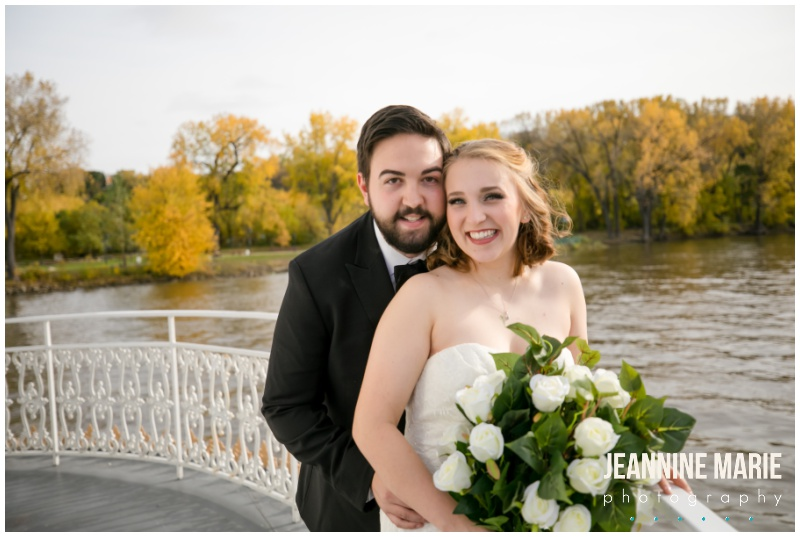 bride, groom, bridal bouquet, white flowers, fall leaves, fall colors, riverboat wedding, Mississippi River, Mississippi River wedding, boat wedding, river wedding, fall wedding, Minnesota fall wedding, Minnesota fall colors, Padelford River Boats, Ink Sweets, Quest Event Services, Onsite Muse, David's Bridal, The Black Tux, Minnesota Bride, Minnesota wedding photographer, Minneapolis wedding photographer, Saint Paul wedding photographer, Jeannine Marie Photography