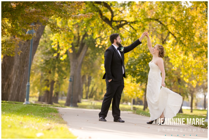 dancing, twirling, couple, smiling, eskimo kisses, fall leaves, riverboat wedding, Mississippi River, Mississippi River wedding, boat wedding, river wedding, fall wedding, Minnesota fall wedding, Minnesota fall colors, Padelford River Boats, Ink Sweets, Quest Event Services, Onsite Muse, David's Bridal, The Black Tux, Minnesota Bride, Minnesota wedding photographer, Minneapolis wedding photographer, Saint Paul wedding photographer, Jeannine Marie Photography