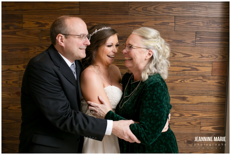 bride, parents, mother of the bride, father of the bride, winter wedding, Christmas wedding, red wedding, Eagan Community Center, Wilderland Floral, Makeup by Mindie, Hair by Theresa, Raffine Bridal, Buttercream, Green Mill Catering, Jeannine Marie Photography, Eagan Community Center wedding photographer, Minneapolis wedding photographer, Eagan wedding photographer, Saint Paul wedding photographer, Minnesota wedding photographer, winter wedding photography