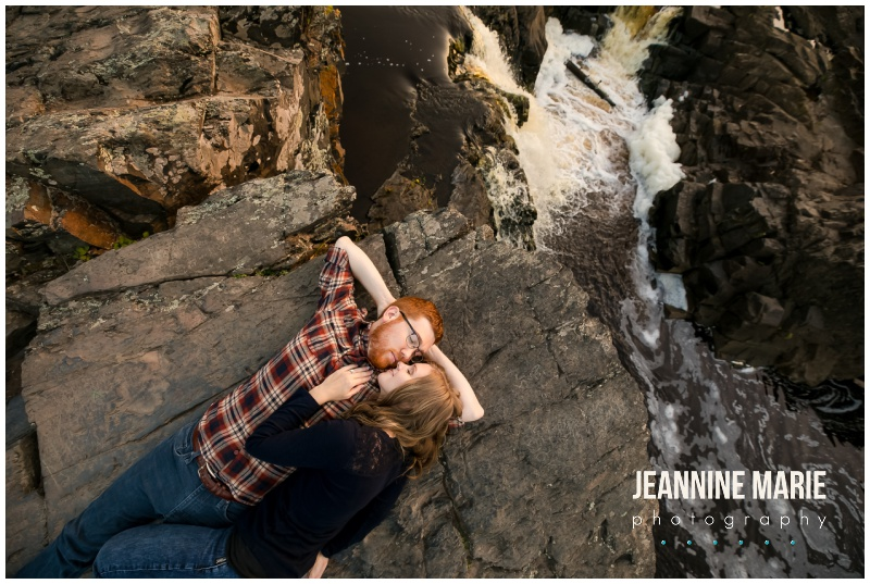 rocks, St. Louis River, river, lying down, cuddle, Jay Cooke State Park, fall colors, Minnesota fall, fall engagement session, Northern Minnesota engagement session, Duluth engagement session, Jeannine Marie Photography, Northern Minnesota engagement photographer, Duluth engagement photographer, Minnesota engagement photographer, Twin Cities engagement photographer, Duluth wedding photographer, Minnesota wedding photographer, fall engagement portraits, nature engagement portraits, outdoor engagement portraits