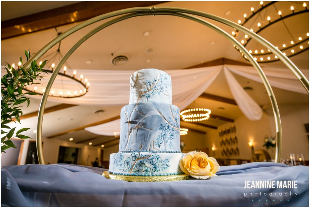 cake, wedding cake, blue cake, floral cake, spring cake, dusty blue wedding, yellow wedding, winter wedding, spring wedding, Minnesota weddings, Majestic Oaks Golf Club, Studio B Floral, We've Got It Covered, 139 Hair by Heidi, Queen of Cakes, Milbern Clothing Co, Hunt Wright Design Co, Marie Wulff, Jeannine Marie Photography, Minnesota wedding photographer, Saint Paul wedding photographer, Minneapolis wedding photographer, Twin Cities wedding vendors, Minnesota wedding vendors, wedding reception, wedding ceremony, indoor wedding, wedding inspiration