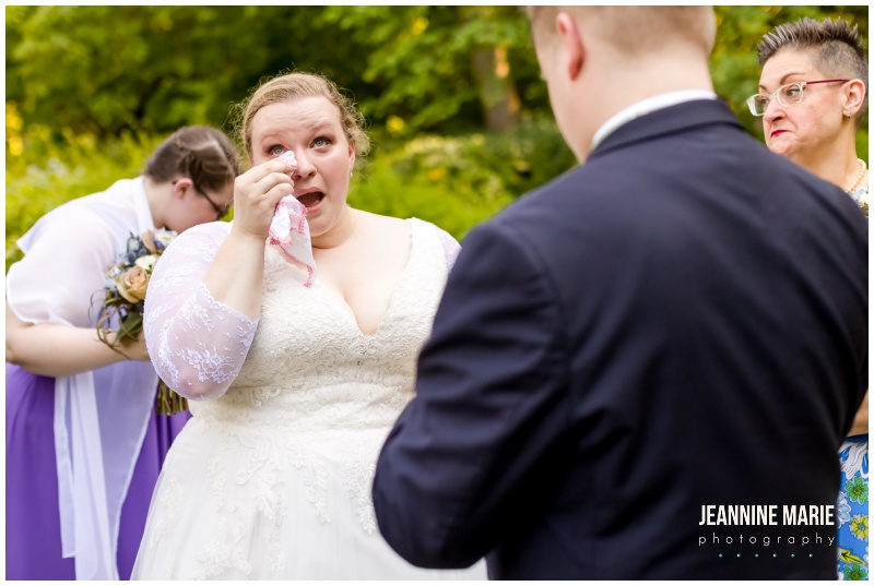 bride wiping tears, wedding ceremony, garden ceremony, outdoor ceremony, lavender and sage wedding, outdoor wedding, Minnesota Landscape Arboretum, The Big Red Barn AirBnb, Pretty Petals by Bridget LLC, Red Bench Bakery, The Parlour Salon & Spa, Luxe Bridal, Keds, Helzberg Diamonds, Azazie, Menguin, Jeannine Marie Photography, Twin Cities wedding, Minneapolis wedding, micro wedding, Twin Cities micro wedding, Minneapolis micro wedding, Wayzata wedding, Chaska wedding, pandemic wedding, COVID wedding, virtual wedding